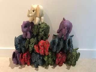 Lightly displayed: various handmade crafted stuffed plushy elephant from thailand tribes social Enterprise
