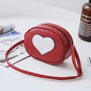 LOVE CUBE SLING BAG