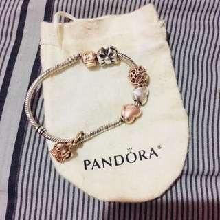 Pandora bracelet with tricolor charms