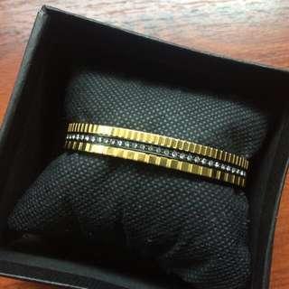 Michael Kors black & gold bangle