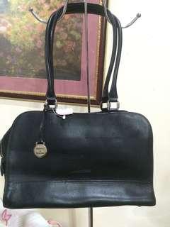Auth Dooney and burke 1000 genuine leather
