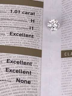 已放大影 可清楚見到鑽石內部的凈度。GIA證 1.01卡 H色 I1 EX/EX/EX  N  HKD$26000。完美車工 八心八箭 冇螢光 唔朦唔黃。video可在個人簡歷和專頁睇。設18K鑲嵌服務