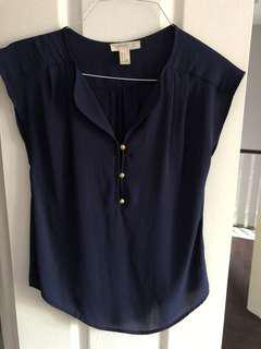 Navy blue top with gold buttons