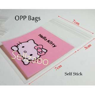 Hello Kitty Opp Bags : 5 Pcs : Plastic : Self Stick : Adhesive : Store : Storage : Sell : Sellers : Selling : Small : Items : Stuff : Accessories : Use : Stationery : Stationeries : See Through : Pink Clear Colour : About 7cm x 7cm : Sellzabo