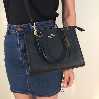 Coach two styles sling bag