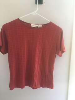 Red shirt, a little bit cropped