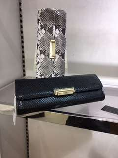 BCBG snakeskin clutches in black white and red