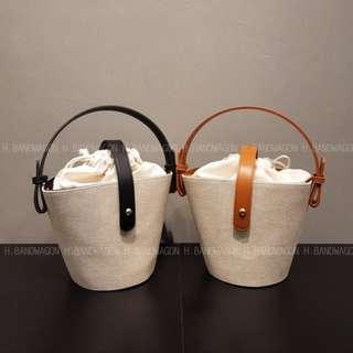 【H.BANDWAGON】韓國簡約綁帶束口皮帶釦造型肩背手提麻邊包 水桶包 竹籃包 海邊 沙灘 夏日