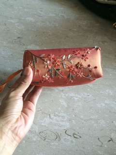 Makeup pouch with embroidery