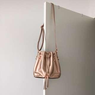 Colette Rose Gold Drawstring Bucket Bag