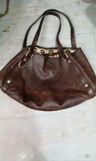 GUCCI..medium size brown colour