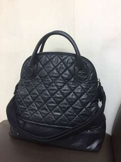 Chanel black leather sport travel bag
