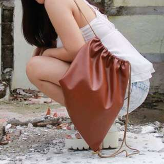 brown leather stringbag