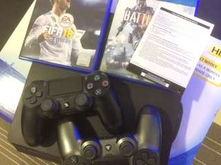 PS4 with 2 controllers and 2 games With one year warranty used 3 months only