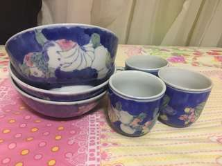 3 Ceramic bowls with a pair of small mugs