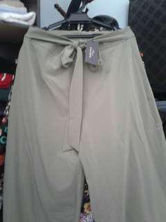 New with tag. Khaki Love high flare Pants .