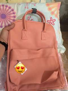 Backpack and Round Sling Bag