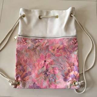 Women's leather pink and white floral drawstring bag