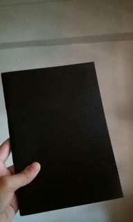 PLAIN BLACK BOOK