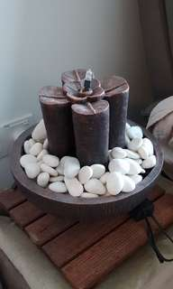 Water fountain feature with light and pebbles