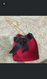 Red velved sling bag with bow