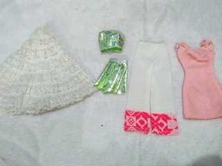 Assorted clothes for barbie