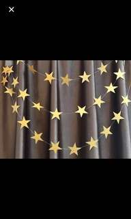 $1.00-$1.50: Non glitter gold star garland