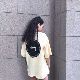 Stussy tee in blk or yellow
