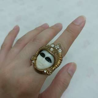 Poker face bronze ring