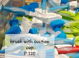 Brush with suction