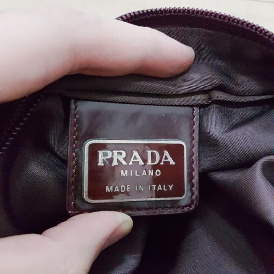 Prada darkbrown nylon slingbag original not gucci hermes bally lv bottega
