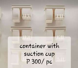 Container with suction cup