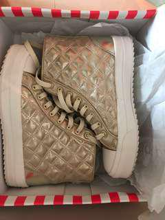 Wore once puzzle shoes gold colour
