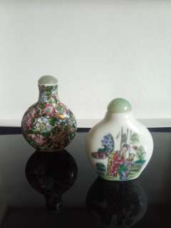 Pair of vintage hand painted snuff bottles