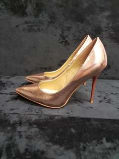 Rose gold pointed toe stilettos