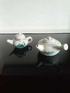 Pair of miniature porcelain tea pots