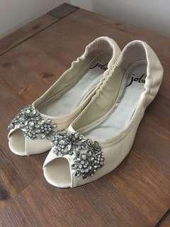 Ivory flat shoes