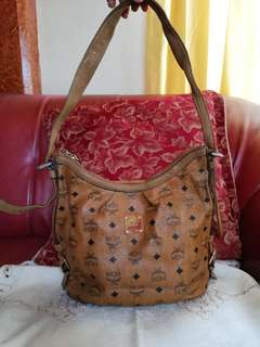 Authentic MCM sling/shoulder vintage with padlock and carecard