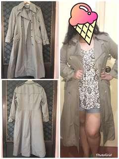 Long trench coat fits medium to semi large