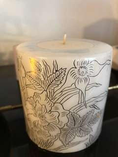 Modern candle with flower pattern