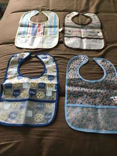 Take all four - plastic baby bibs
