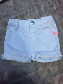 H&M white denim shorts with small pink heart detail