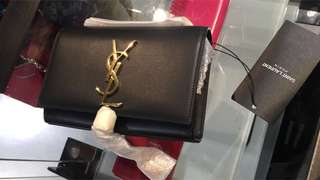 YSL clutch bag with tussle