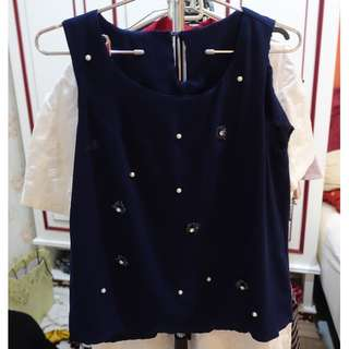 Sleeveless top with beads