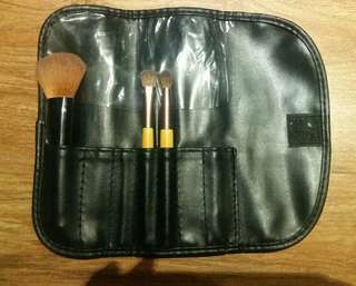 Makeup brushes with brush holder.