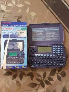 Sharp EL 6750 vintage electronic personal orgainser