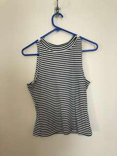 Striped sleeveless turtle neck