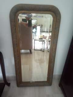 Antique mirror with carved wood gilded frame