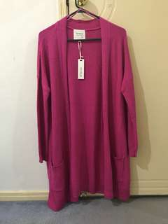 Long pink knitted cardigan