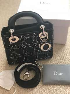 Dior Handbag. Mini lady Dior bag in black cannage satin with rhinestones